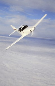 Glasair III Banking Above Clouds
